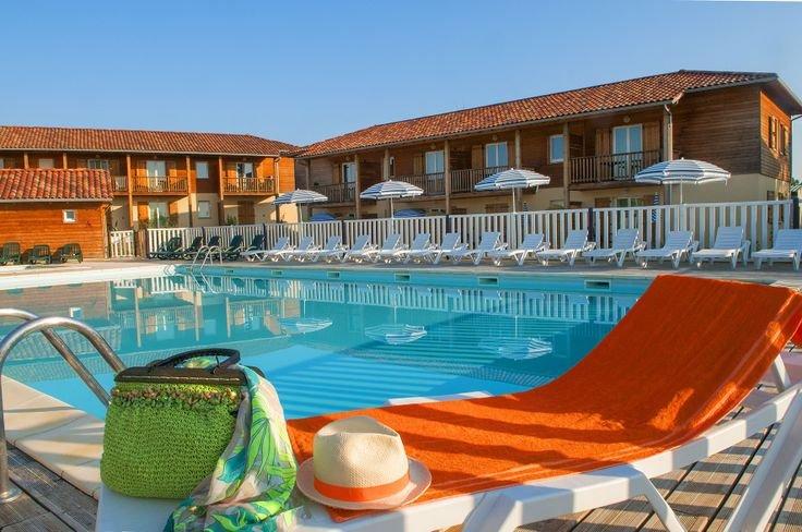Piscine de la résidence de vacances  Goelia Les maisons du Golf d'Armagnac à Eauze.