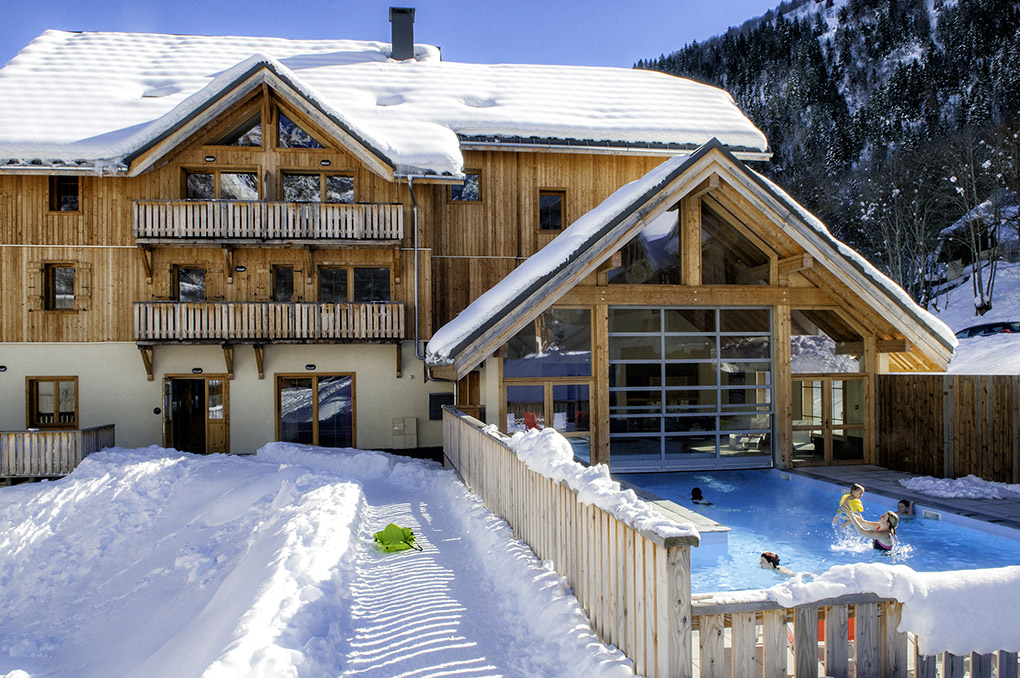 The Goélia Les Chalets de Belledonne holiday complex in St Colomban les Sybelles and its heated pool